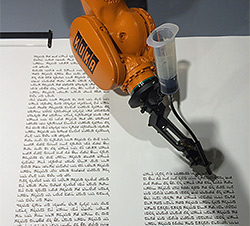 Robot writes a Torah Scroll